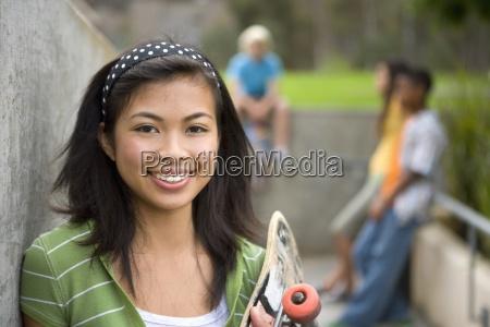 teenage girl 13 15 with skateboard