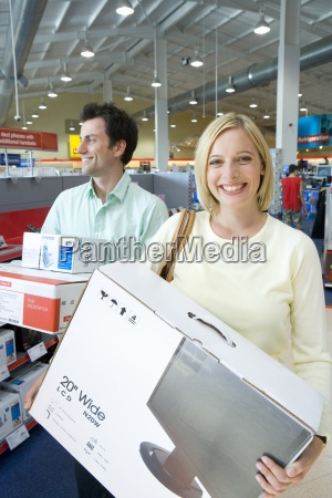 young couple shopping woman with computer