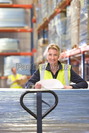 portrait of smiling female warehouse worker