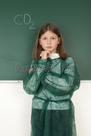 girl at blackboard while thinking