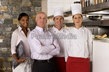 proud restaurant manager standing with waitress