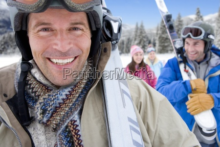 man in snow field wearing goggles