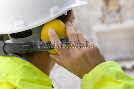 construction worker wearing ear protectors