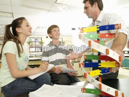 science teacher talking to teenagers 15