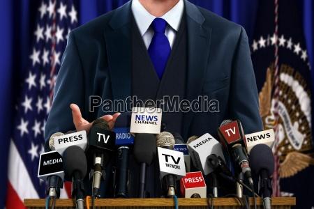 politician presso press conference