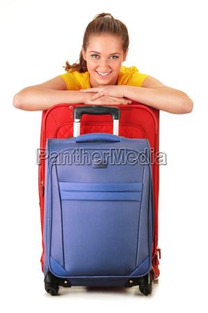 giovane donna con valigie da viaggio
