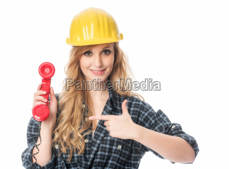 handyman pointing at telephone handset