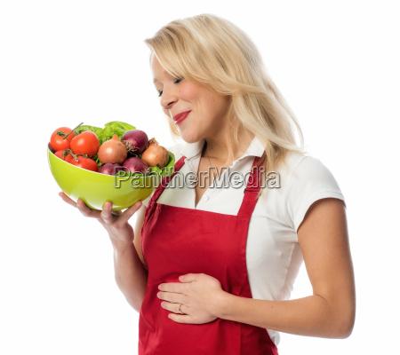 casalinga in grembiule in possesso di