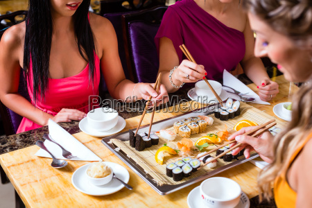young people eating in chinese restaurant