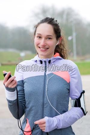 donna telefono musica sport dello sport
