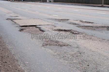pericolo asfalto riparazione autostrada buco riparare