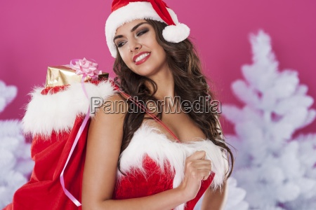 woman with santa clauss bag with