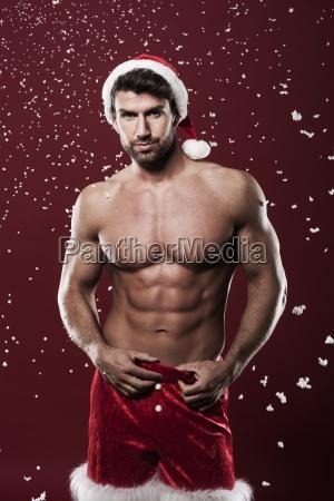 sexy man wearing santa claus clothes