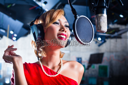 asian singer producing song in recording