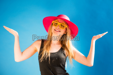 blond woman with sunglasses and straw