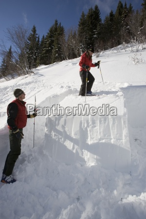 backcountry skiers perform rutschblock test