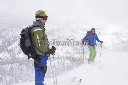 two backcountry skiers on a ridge