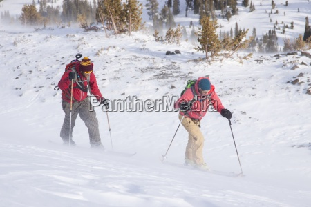 two backcountry skiers in pony montana