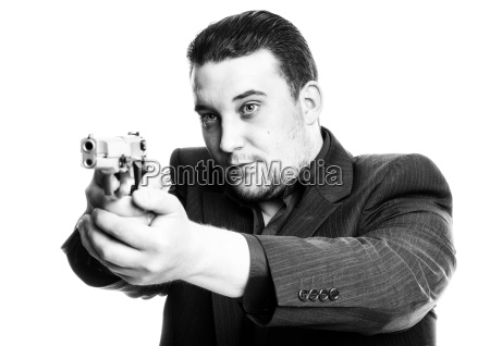 agent aims with a weapon