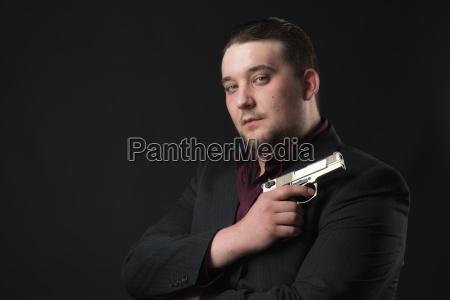 young man points a gun