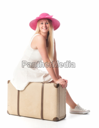 girl sitting on a suitcase and