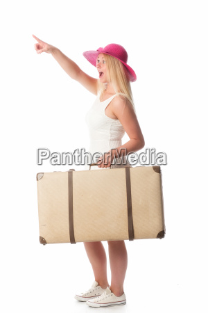woman with suitcase pointing at something