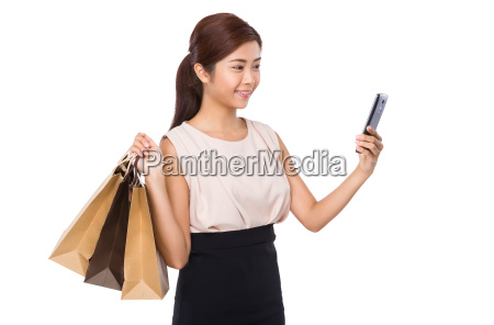 young woman with shopping bag and