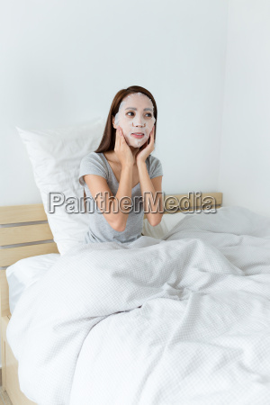asian woman using the paper mask