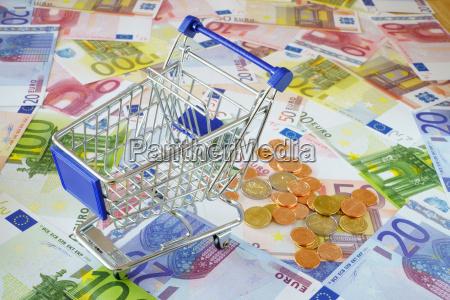 consumo monete negozio comperare banconote carrello