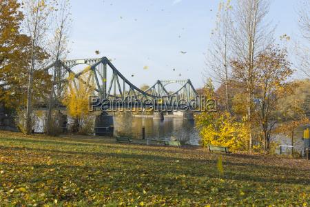 leaves fall on glienicker bridge