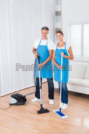 two janitors with vacuum cleaner and