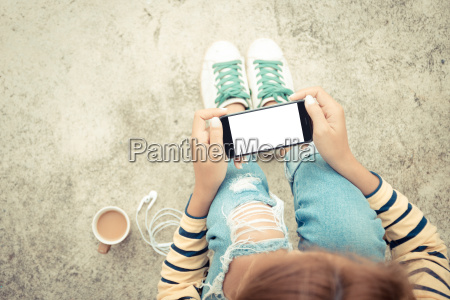 woman holding phone white screen on