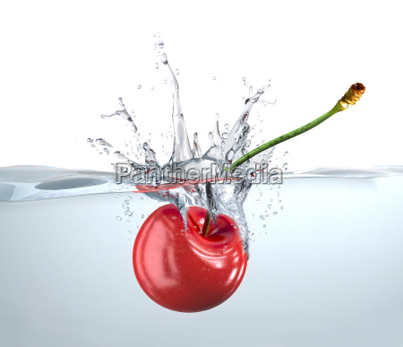 red cherry falling into water and