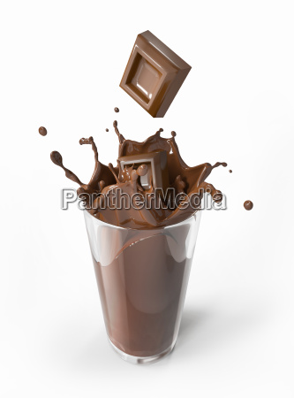 chocolate blocks falling into a glass