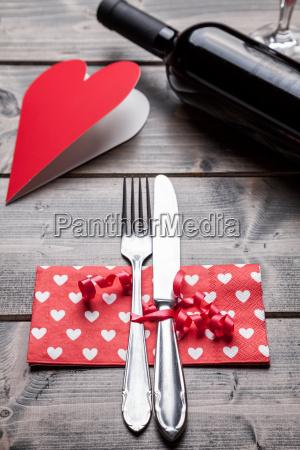 romantic dinner set on wooden background