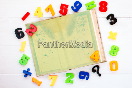 colorful plastic numbers and open book