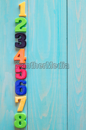 set of plastic numbers on wooden