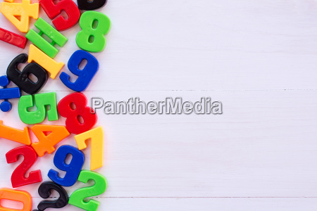 border of colorful toy magnetic numbers