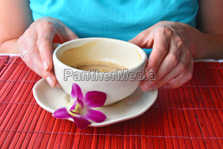 two woman hands holding coffee cup