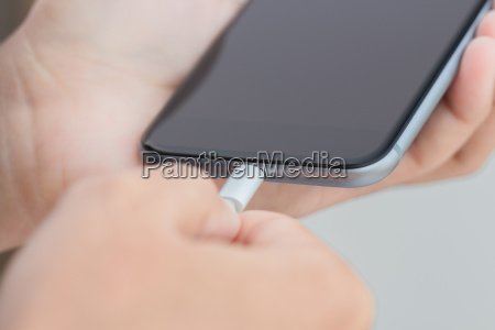 close up hand using usb cable