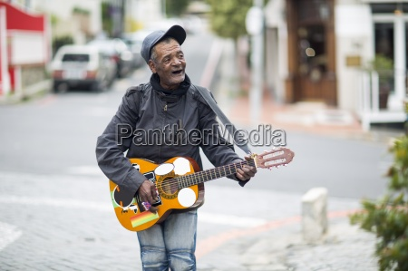 street musician singing and playing guitar