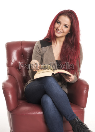 red haired girl sits on a