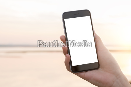 phone in female hand at outdoor