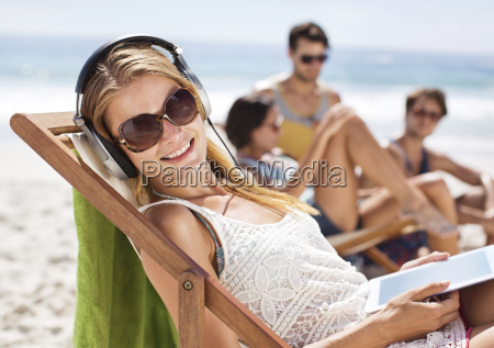 portrait of happy woman listening to