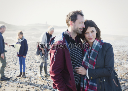 portrait couple hugging on sunny rocky