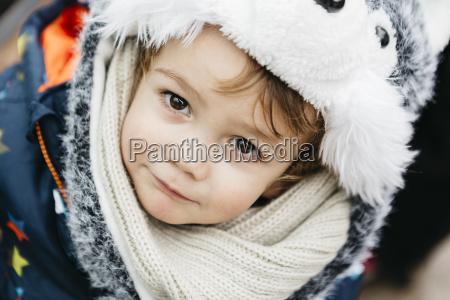 portrait of little boy wearing warm