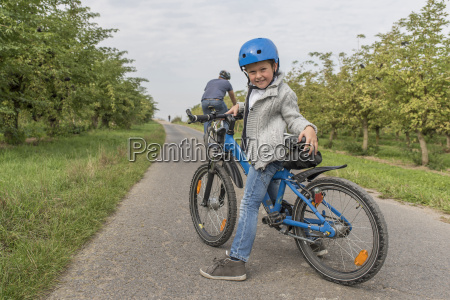 portrait of little boy on bicycle