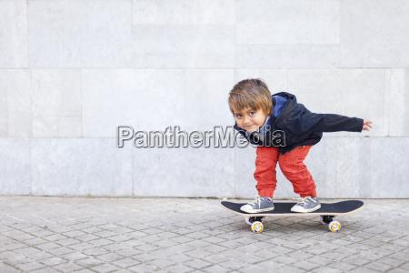 portrait of little boy balancing on