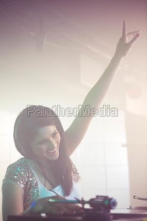 pretty female dj waving her hand