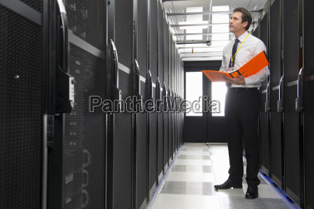manager with folder checking aisle of